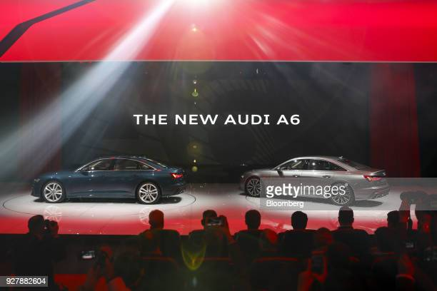 The new model Audi A6 automobiles sit on display at the Audi AG stand on the opening day of the 88th Geneva International Motor Show in Geneva...