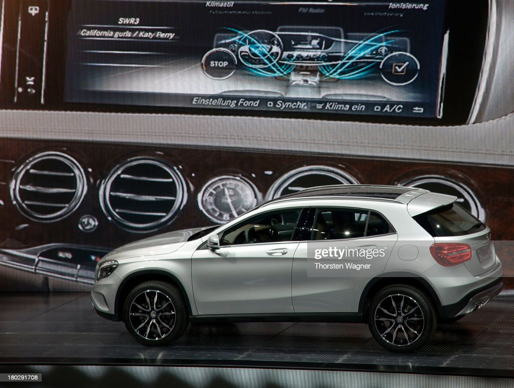 The new model of Mercedes called GLA is infront of the video wall during the press day at the international motor show IAA (Internationale Automobil-Ausstellung) on September 11, 2013 in Frankfurt am Main, Germany. The world's biggest motor show, the IAA, is running from September 12 to 22, 2013