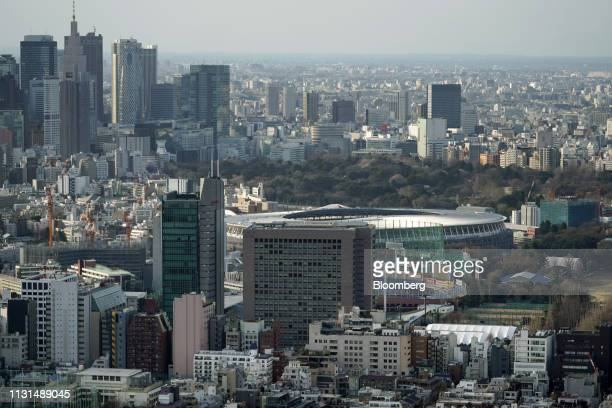 The New National Stadium center a venue for the 2020Olympicand Paralympic Games stands under construction in Tokyo Japan on Monday March 18 2019...