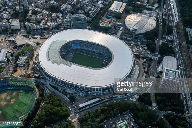 The New National Stadium the main stadium for the Tokyo 2020 Olympics and the Tokyo Metropolitan Gymnasium are pictured on July 24 2019 in Tokyo...