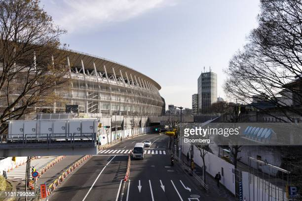 The New National Stadium the main venue for the Tokyo 2020 Olympic and Paralympic Games left stands under construction in Tokyo Japan on Wednesday...