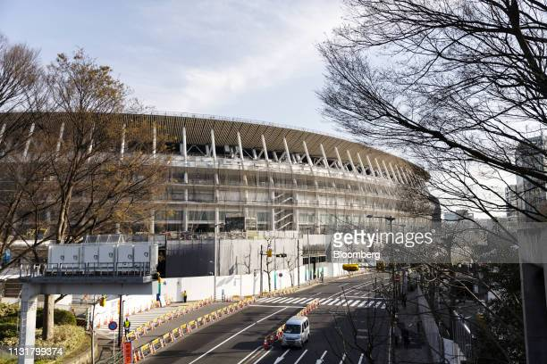 The New National Stadium the main venue for the Tokyo 2020 Olympic and Paralympic Games stands under construction in Tokyo Japan on Wednesday March...