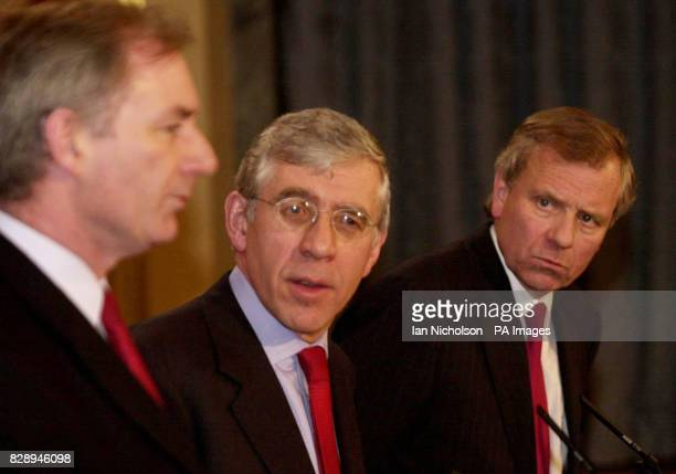The new NATO secretary general General Jaap De Hoop Scheffer right with Foreign Secretary Jack Straw and Defence Secretary Geoff Hoon at a news...
