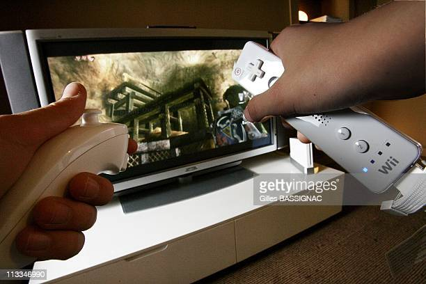 The New Nintendo Wii Console A New Way To Play With The Wireless Remote And The Nunchuk In Paris France On December 06 2006 In a tennis game the...