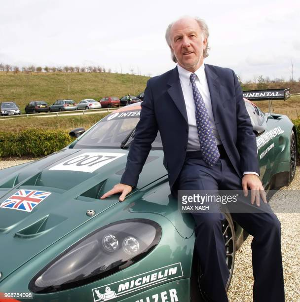 The new nonexecutive Chairman of the British Aston Martin sports car firm David Richards sits on one of the firms cars during a press conference...