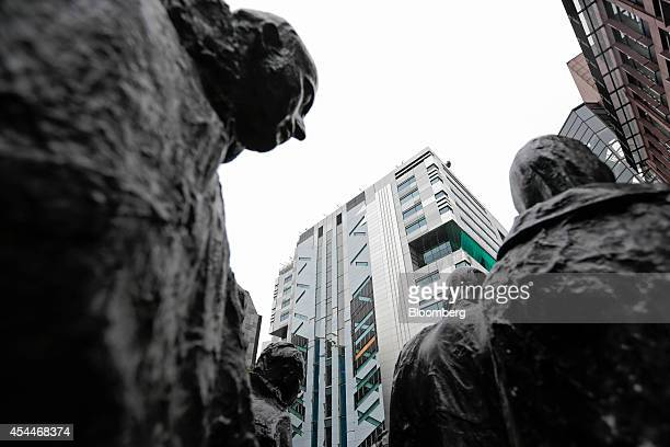 The new office complex of UBS AG at No 5 Broadgate center stands beyond a sculpture entitled 'Rush Hour' by George Segal in London UK on Monday Sept...
