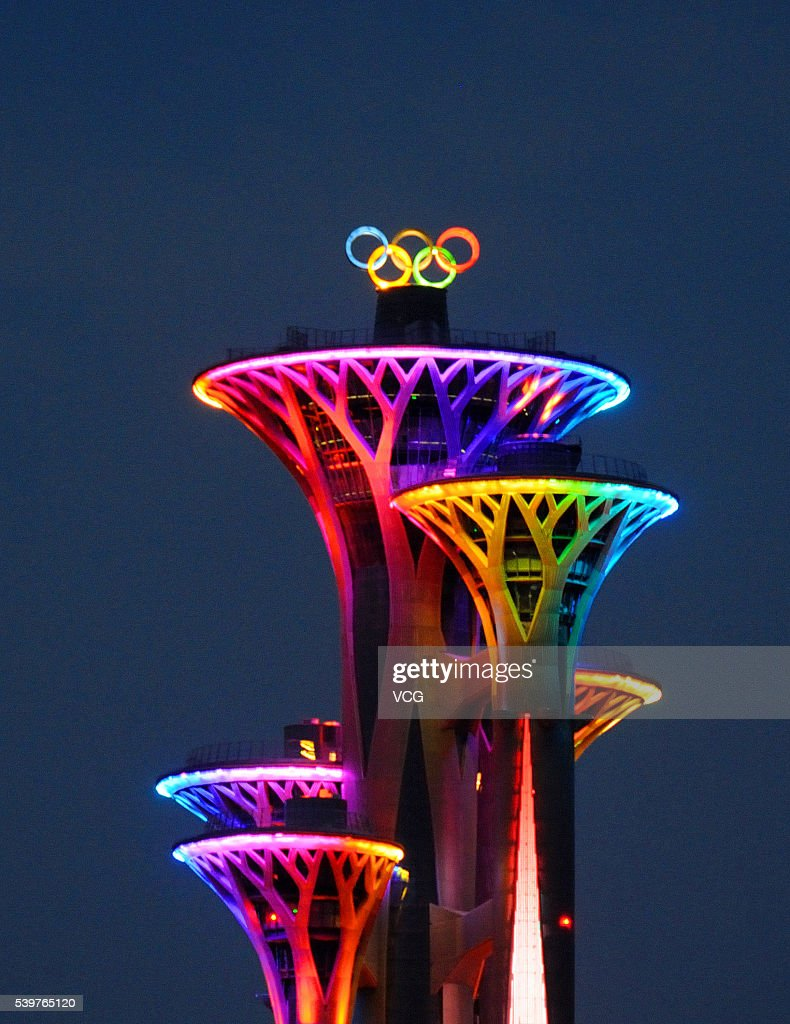 New olympic rings symbol lights up for the first time in beijing the new olympic rings symbol on the beijing olympic tower lights up for the first time biocorpaavc Choice Image