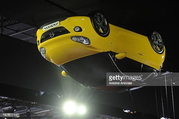 The new Opel Adam car is suspended from the roof of the Paris Auto Show on September 27 2012 in Paris France Opel which has been owned by General...