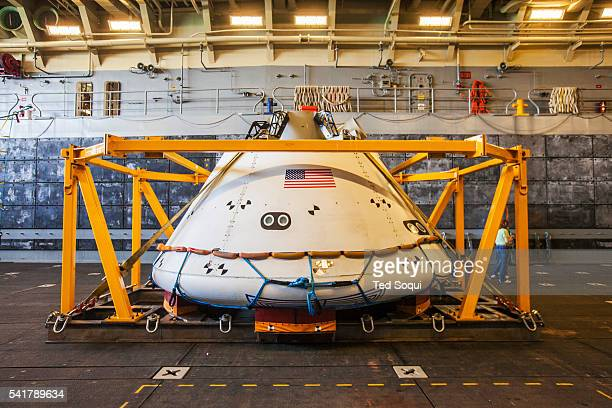 The new Orion space capsule from NASA that will carry astronauts to Mars and back The USS Anchorage is practicing retrieving the capsule at sea This...