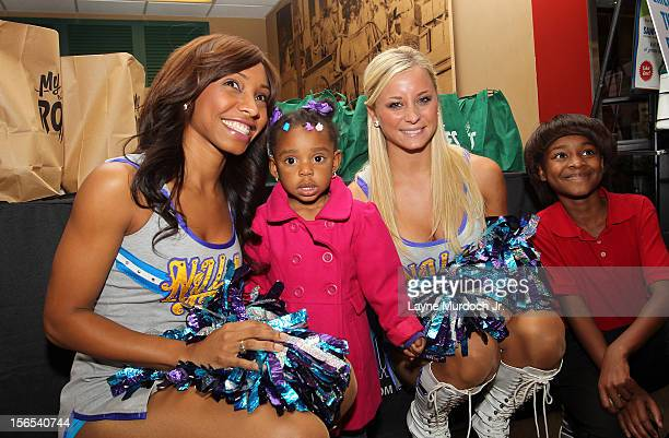 The New Orleans Hornets Honeybees help distribute Thanksgiving baskets provided by the Hornets and Rouses to Emerge students on November 15 2012 at...