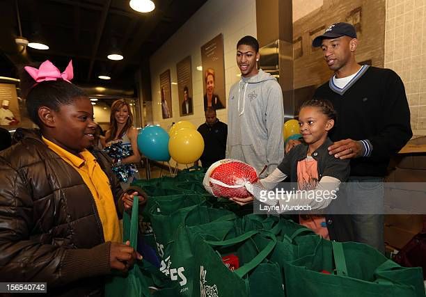 The New Orleans Hornets led by Head Coach Monty Williams and forward Anthony Davis distribute Thanksgiving baskets provided by the Hornets and Rouses...