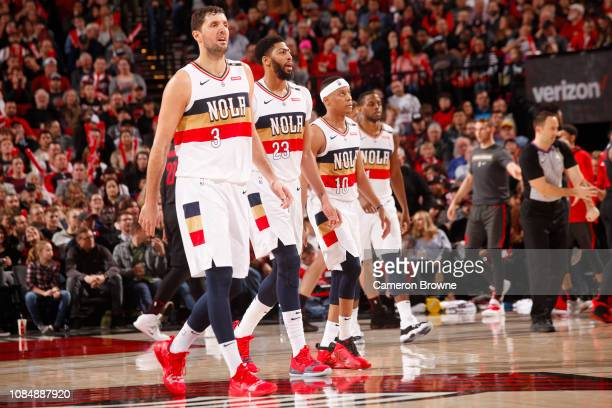 The New Orleans Pelicans all walk onto the court during the game against the Portland Trail Blazers on January 18 2019 at the Moda Center Arena in...