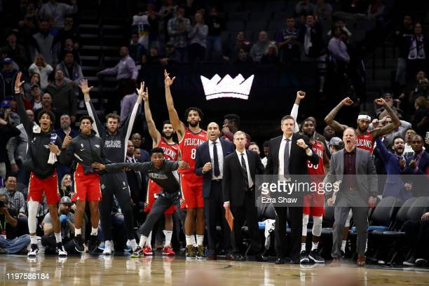 The New Orleans Pelicans bench celebrates after JJ Redick of the New Orleans Pelicans made the game winning shot over Richaun Holmes and Cory Joseph...