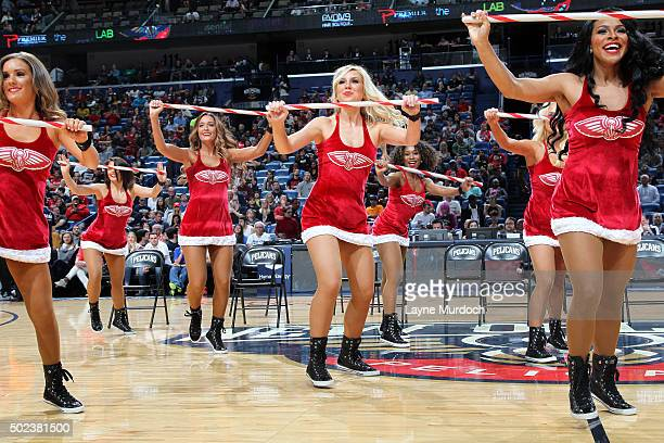 The New Orleans Pelicans cheerleaders perform their routine during the game against the Portland Trail Blazers on December 23 2015 at the Smoothie...