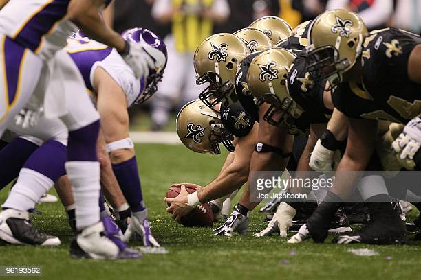 The New Orleans Saints center the ball at the line of scrimmage for a long snap against the Minnesota Vikings during the NFC Championship Game at the...