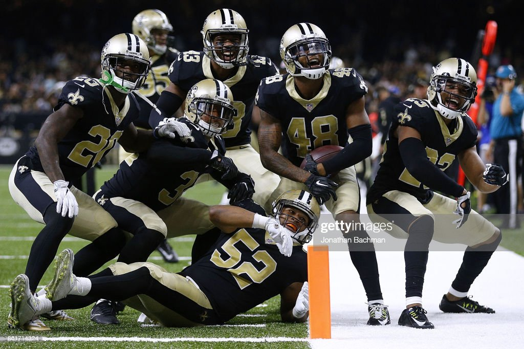 The New Orleans Saints defense celebrates during the second half of a game against the Detroit Lions at the Mercedes-Benz Superdome on October 15, 2017 in New Orleans, Louisiana.