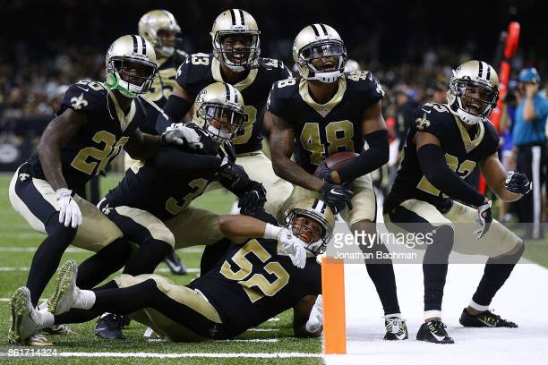 The New Orleans Saints defense celebrates during the second half of a game against the Detroit Lions at the Mercedes-Benz Superdome on October 15,...