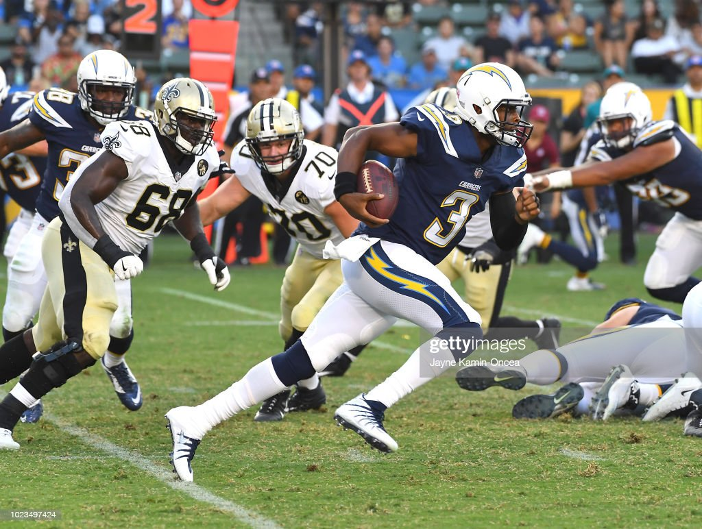 The New Orleans Saints defense pressures quarterback Geno Smith #3 of the Los Angeles Chargers as he runs the ball in the third quarter of the preseason game at StubHub Center on August 25, 2018 in Carson, California.