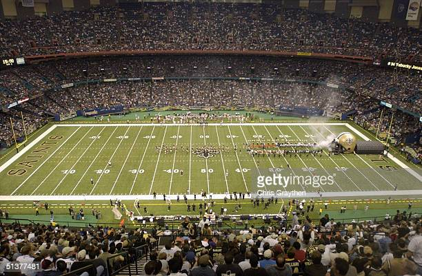 The New Orleans Saints enter the field before the game against the San Francisco 49ers at the Louisiana Superdome on September 19 2004 in New Orleans...