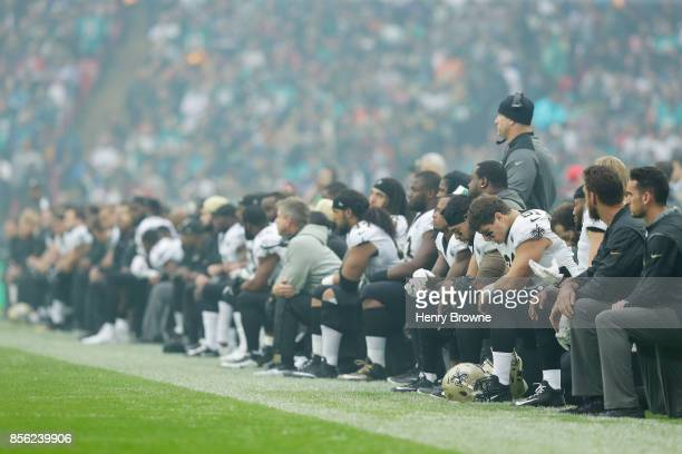 The New Orleans Saints players kneel before the anthem is played at the NFL game between the Miami Dolphins and the New Orleans Saints at Wembley...