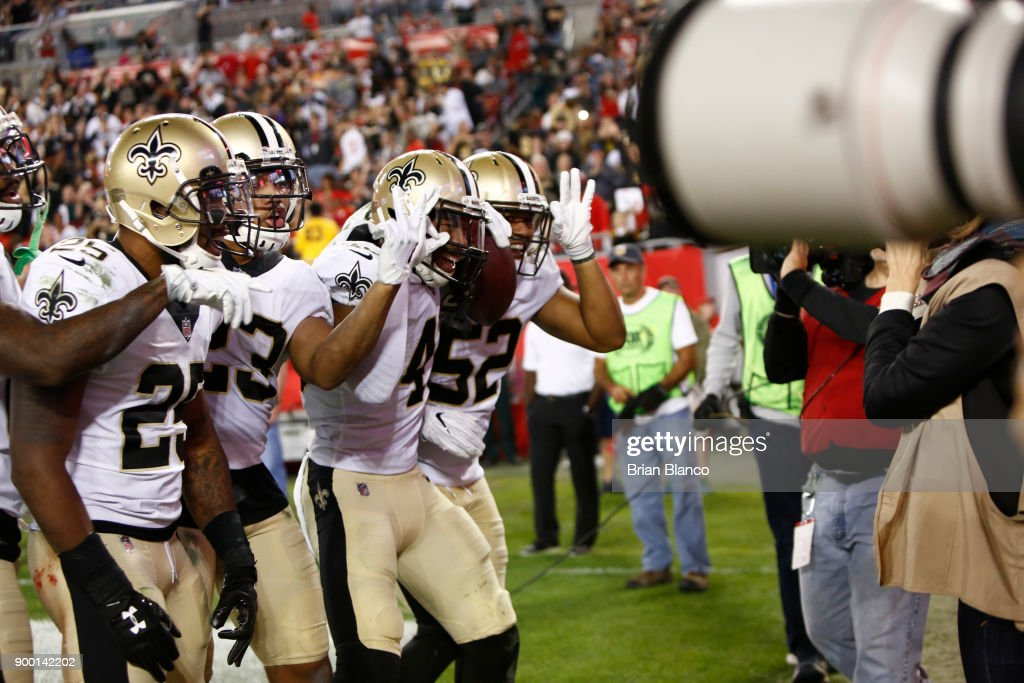 The New Orleans Saints pose for a team photo as they celebrate an interception in the end zone by free safety Marcus Williams #43 of the New Orleans Saints during the third quarter of an NFL football game against the Tampa Bay Buccaneers on December 31, 2017 at Raymond James Stadium in Tampa, Florida.