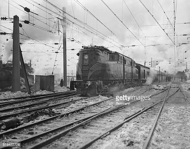 The new Penn R.R. Electric train as it left Washington on its first run to New York. Many prominent officials in government were aboard. Secretary...