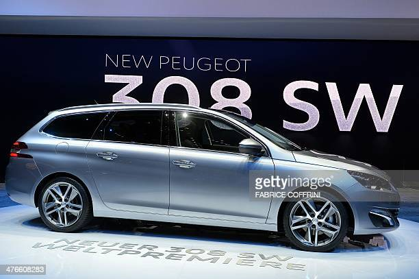 The new Peugeot 308 SW model car is displayd at the French carmaker's booth during the press day of the Geneva Motor Show in Geneva on March 4 2014...