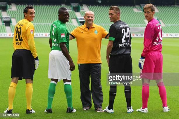 The new player Raphael Wolf Assani Lukimya head coach Thomas Schaaf Nils Petersen and Richard Strebinger of Bremen pose at Weser Stadium on July 5...