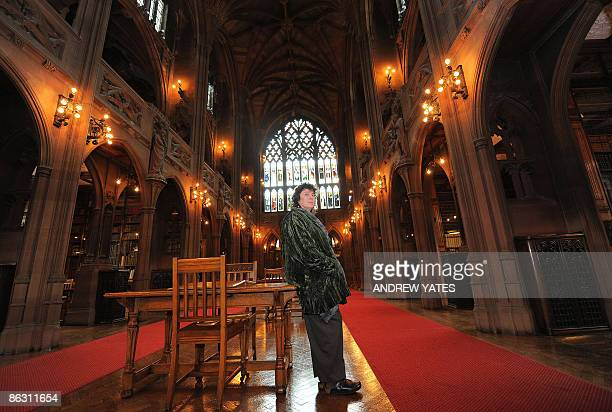 The new Poet Laureate Carol Ann Duffy poses for photographers in the John Rylands Library, in Manchester, north-west England, on May 1, 2009. Britain...