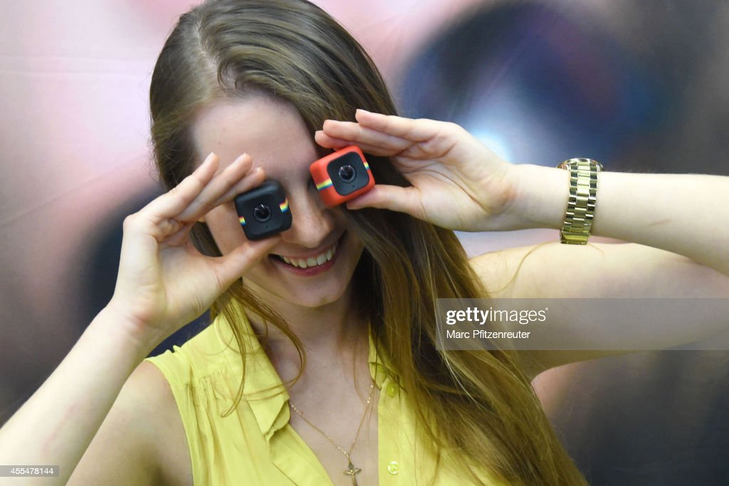 The new Polaroid Cube action cameras are presented during the press preview of the Photokina 2014 trade fair on September 15, 2014 in Cologne, Germany. Photokina is the world's largest trade fair for cameras and photographic equipment.