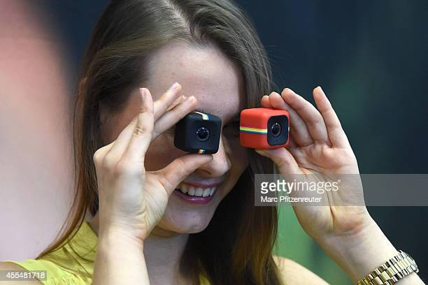 The new Polaroid Cube action cameras are presented during the press preview of the Photokina 2014 trade fair on September 15 2014 in Cologne Germany...