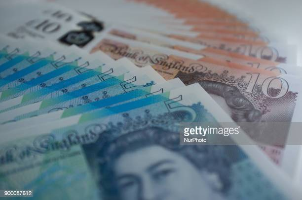 The new polymer British ten and five pounds banknotes are pictured in London on December 31 2017 Currency experts have warned that as the uncertainty...
