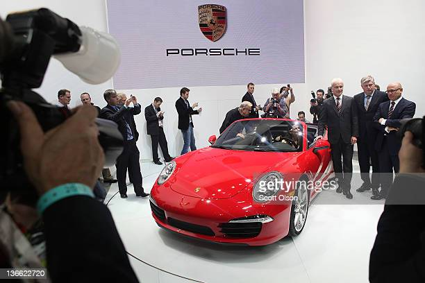 The new Porsche 911 Carrera Cabriolet is introduced during the press preview at the North American International Auto Show at the COBO Center on...
