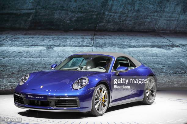 The new Porsche AG 911 Carrera 4S luxury automobile sits on display on the opening day of the 89th Geneva International Motor Show in Geneva...