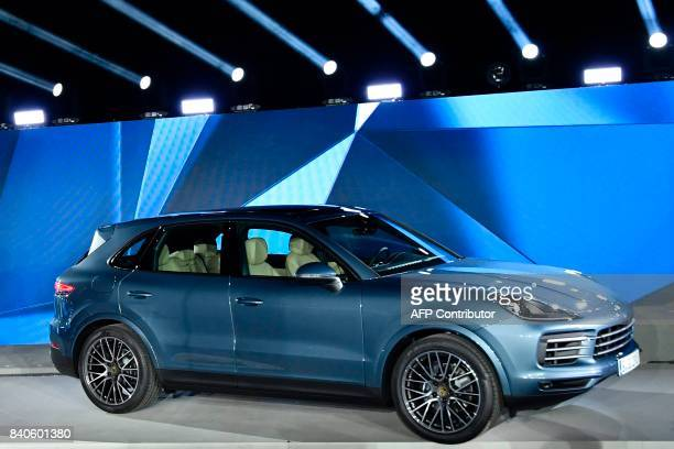The new Porsche Cayenne is unveiled at the heahquarters of German carmaker Porsche in Stuttgart southwestern Germany on August 29 2017 / AFP PHOTO /...