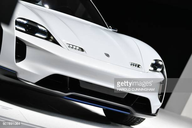 The new Porsche Mission E Cross Turismo is displayed at the car maker's booth during a press day ahead of the Geneva International Motor Show on...