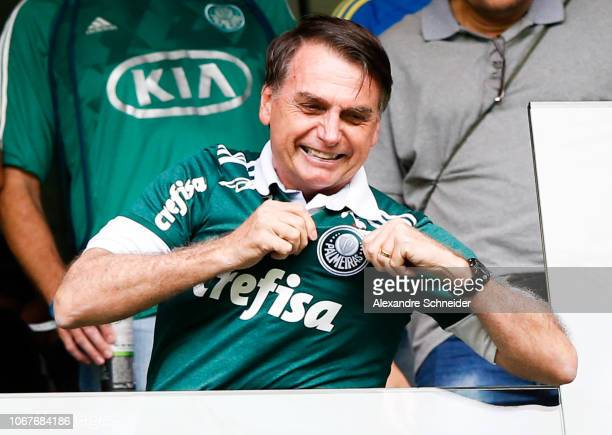 The new president elected Jair Bolsonaro waves to the fans before the match between Palmeiras and Vitoria for the Brasileirao Series A 2018 at...