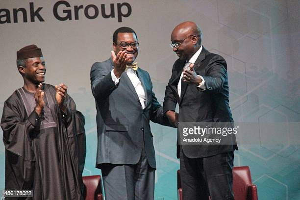 The new president of the African Development Bank Akinwum Adesina is congratulated by AFDB outgoing president Donald Kaberuka during Akinwumi Adesina...