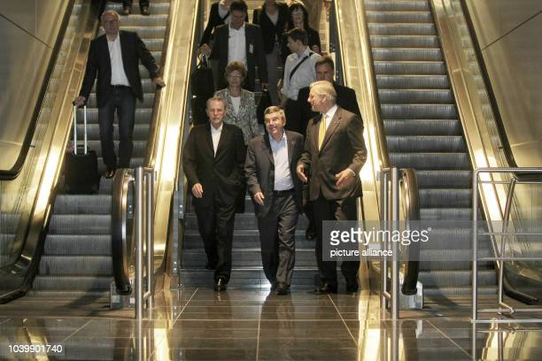 The new president of the International Olympic Committee Thomas Bach arrives at the airport in Frankfurt Main with his predecessor Jacques Rogge and...