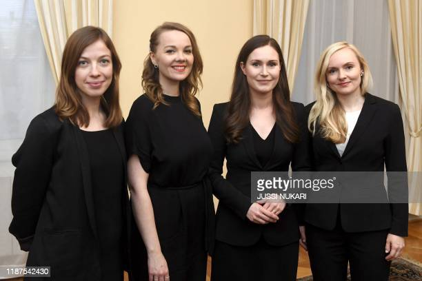 The new Prime Minister of Finland Sanna Marin poses with Minister of Education Li Andersson Minister of Finance Katri Kulmuni and Minister of...