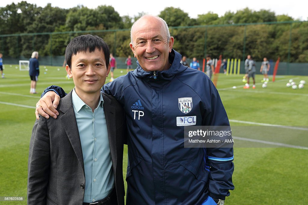 The new prospective owner of West Bromwich Albion, Guochuan Lai from Yunyi Guokai (Shanghai) Sports Development Limited meets Tony Pulis the head coach of West Bromwich Albion whilst on a tour of the club on August 8, 2016 in West Bromwich, England.
