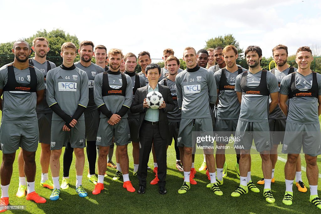 The new prospective owner of West Bromwich Albion, Guochuan Lai from Yunyi Guokai (Shanghai) Sports Development Limited meets some of the first team squad of West Bromwich Albion whilst on a tour of the club on August 8, 2016 in West Bromwich, England.