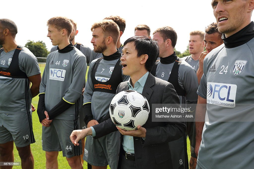 The new prospective owner of West Bromwich Albion, Guochuan Lai from Yunyi Guokai (Shanghai) Sports Development Limited meets members of the first team squad of West Bromwich Albion whilst on a tour of the club on August 8, 2016 in West Bromwich, England.