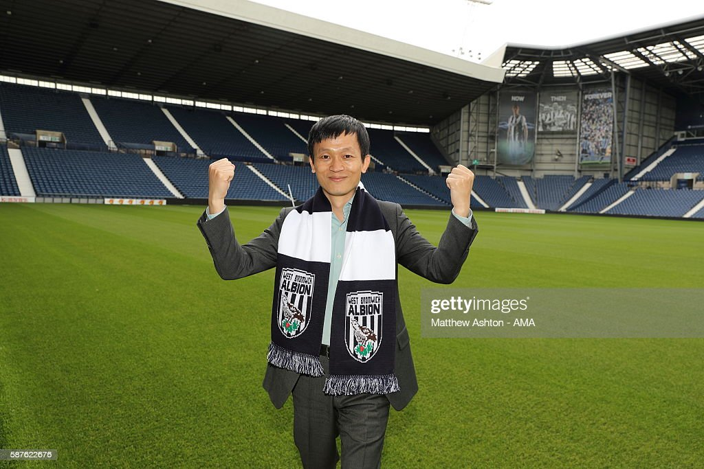 The new prospective owner of West Bromwich Albion, Guochuan Lai from Yunyi Guokai (Shanghai) Sports Development Limited on the pitch at The Hawthorns Stadium whilst on a tour of the club on August 8, 2016 in West Bromwich, England.