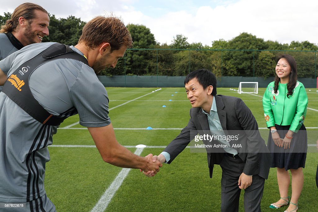 The new prospective owner of West Bromwich Albion, Guochuan Lai from Yunyi Guokai (Shanghai) Sports Development Limited meets Craig Dawson of West Bromwich Albion whilst on a tour of the club on August 8, 2016 in West Bromwich, England.