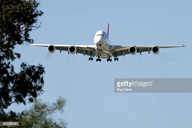 The new Qantas A380 lands in Perth for the first time following it's arrival in Australia on September 21 at the Perth International Airport on...