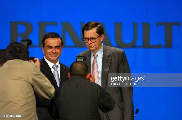 The new Renault automaker CEO French Carlos Ghosn poses with his predecessor French Louis Schweitzer during the Renault general meeting to...