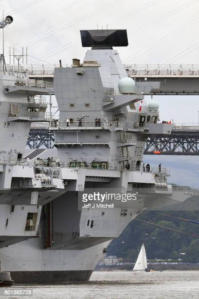 The new Royal Navy aircraft carrier HMS Queen Elizabeth departs Rosyth dockyard to be tested in the North Sea on June 26 2017 in Rosyth Scotland HMS...