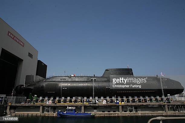 The new Royal Navy submarine HMS Astute emerges from it's berth after being launched by Camilla Duchess of Cornwall at the BAES shipyard on June 8...