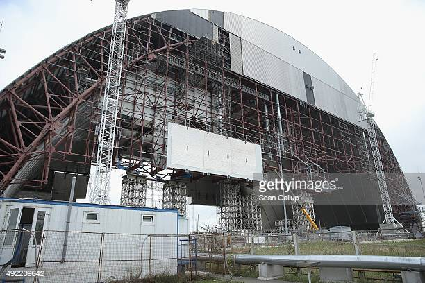 The New Safe Confinement a movable structure 108 meters tall 150 meters long and 257 meters wide stands under construction near the remains of...